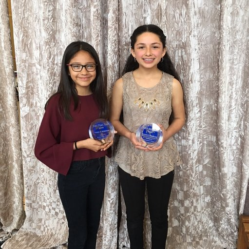 PictureScience Festival winners with their trophies.  Viviana Calderon on the left; Yulissa Cabrera on the right.